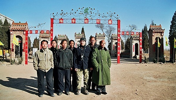 Meihuazhuang practitioners stand in front of shrine to founding ancestors